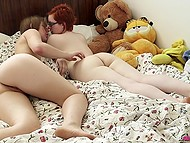 Hairy pussies of nerdy girl with red hair and her lesbian friend need to be licked right now