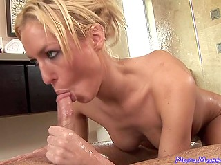 Man relaxes in parlor with blonde MILF masseuse who loves to suck dicks of her clients