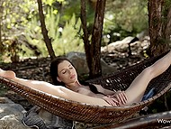 Sunny weather, bird songs, and masturbation in hammock make this brunette really happy