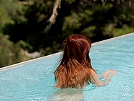 Naked girl with red hair just swims in the pool still it's enough to make guys' cocks hard 8