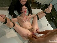 Two guys take turns roughly penetrate in the ass bound young bitches