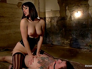 Come-hither diva goes mad and ties up guy riding him and jerking off in dark cellar