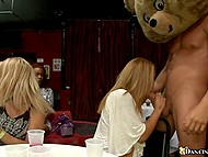 Girls choke and take cock of stripper wearing a bear costume deep in mouths till facial