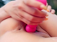 Hungarian young woman Candy Sweet uses dildo for pussy satisfaction outdoors on camera 11