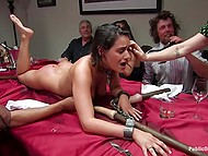 Humiliated Latina girl is on all fours on the table and special sticks visit her pussy and mouth 11