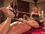 Two pornstars get off on spanking hogtied slave boy and cum from cunnilingus then making him lick toes 4