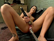 Brunette girl in fishnets satisfies pussy using vibrator and realizes that she needs a fucking machine