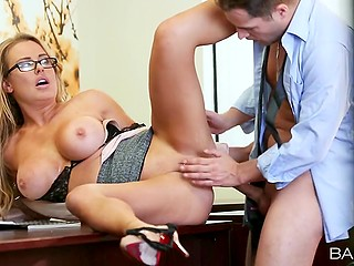 Lovable secretary with huge boobies and glasses provides sexual pleasure to boss in his office