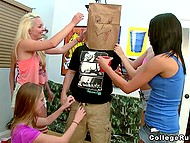 Girls put paper bag on lucky guy's head and one of the coeds pampers his cock with mouth 4
