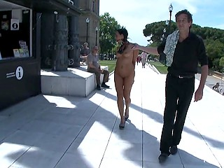 Man walks naked Latina girl on a leash in the streets and most of the passers-by film them