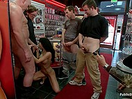 Naked Latina chick with big tits is handcuffed and there are guys who wish to fuck her right away 11