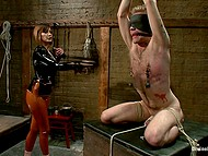 Merciless girl in latex clothes flogs tied up man with blindfold and attaches clamps to nipples 10