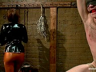 Merciless girl in latex clothes flogs tied up man with blindfold and attaches clamps to nipples 8
