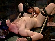 Brunette dominant girl with big tits analyzes tied up slave using strapon and spanks his ass 4