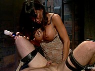 Brunette dominant girl with big tits analyzes tied up slave using strapon and spanks his ass 5