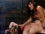 Brunette dominant girl with big tits analyzes tied up slave using strapon and spanks his ass 8