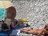 Two couples have sex on the stony beach and they don't know that voyeur films them 5