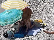 Two couples have sex on the stony beach and they don't know that voyeur films them