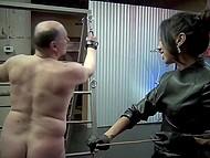 Slender brunette dominatrix punishes tied up mature guy using her favorite whip 8