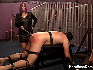 Stunning dominatrix and her athletic colleague spank submissive slave in various ways