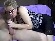 Guy jerks off sitting on the couch when experienced mature woman comes and helps him cum 11