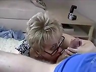 Guy jerks off sitting on the couch when experienced mature woman comes and helps him cum 4