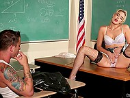 Nerdy teacher in fishnet stockings puts an eye on bully and gives him blowjob lying on the table
