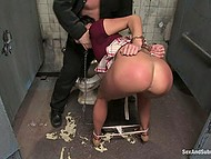 Chained up brunette's mouth filled with cock because she loves feeling hard tool entering her throat 7