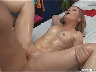 Amazing chick oiled and fingered by masseur asking him then for coition and orgasm