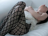 Female plays with wet young cherry masturbating with fishnet black tights pulled down a bit 3