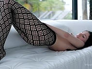 Female plays with wet young cherry masturbating with fishnet black tights pulled down a bit 6