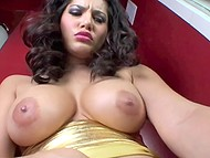 Indian woman Sunny Leone shoves a vibrator into shaved vagina and moves slowly to orgasm