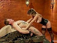 Female makes tattooed young man suck strapon and gets on top of him to ride on dick 11