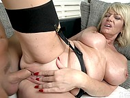 Handsome fellow stretches mature blonde Milf Amy before finishing on her big boobs