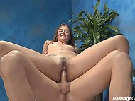 Attractive masseuse actively rides client's cock on table for a reward with cum on her face