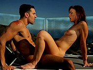 Slender brunette and her well-built partner tenderly make love on the roof under sun 9