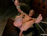 Tied up girl with vaginal and anal piercing figures out what real pain means during BDSM scene