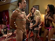 The linked humiliation submissive does mistress in black corset and stockings Aiden Starr