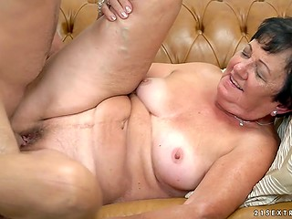 Grey haired granny in stockings fucks the boy porn video