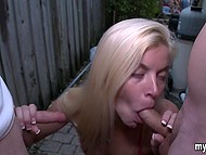 Blonde gags outdoors on two erect cocks of her friends and is rewarded with man juice 7