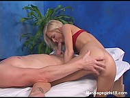 Good-looking blonde massages client but interrupts process to give him great blowjob