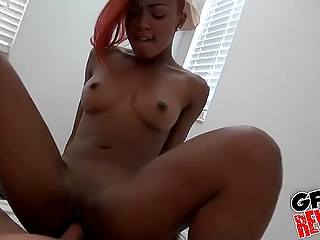 Small-tittied black redhead fucked in straight and reverse cowgirl position by white male