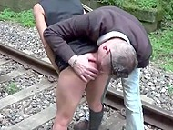 Slender redhead in mask and Italian man have amazing quickie outdoors on railway 5