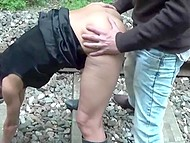 Slender redhead in mask and Italian man have amazing quickie outdoors on railway 7