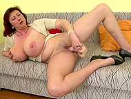 Attractive mature diva with red hair with super-big natural melons enjoys dildo in trimmed snatch 10