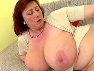 Attractive mature diva with red hair with super-big natural melons enjoys dildo in trimmed snatch 9