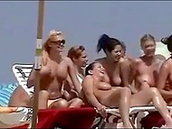 Voyeur finds out about nudist beach and comes there to film hot naked chicks