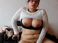 Chesty mature woman sucks dildo on webcam and jumps on it making round jugs bounce 11