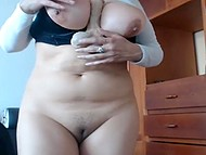 Chesty mature woman sucks dildo on webcam and jumps on it making round jugs bounce
