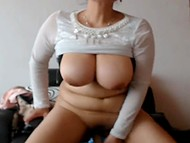 Chesty mature woman sucks dildo on webcam and jumps on it making round jugs bounce 9